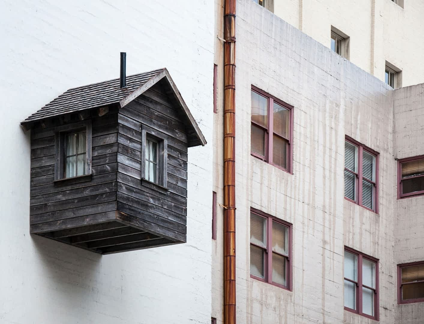 when_is_it_time_to_redesign_my_website blog cover with house on wall