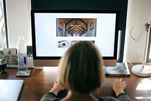 Woman doing website design at a computer for her website