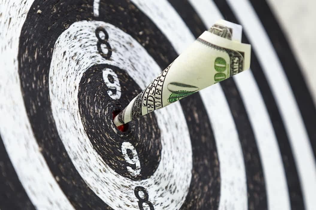 Dart board with 100 dollar bill in the bulls eye signifying great website design