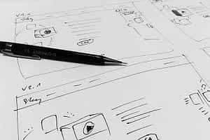 Responsive website design mockup being drawn on paper