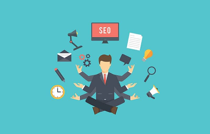 Cartoon of man sitting with many task icons around him and showing SEO on a computer screen