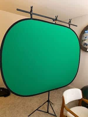 Zoom meeting tips green screen hanging from t shaped stand