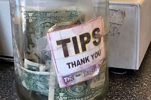 Food jar containing money for tips