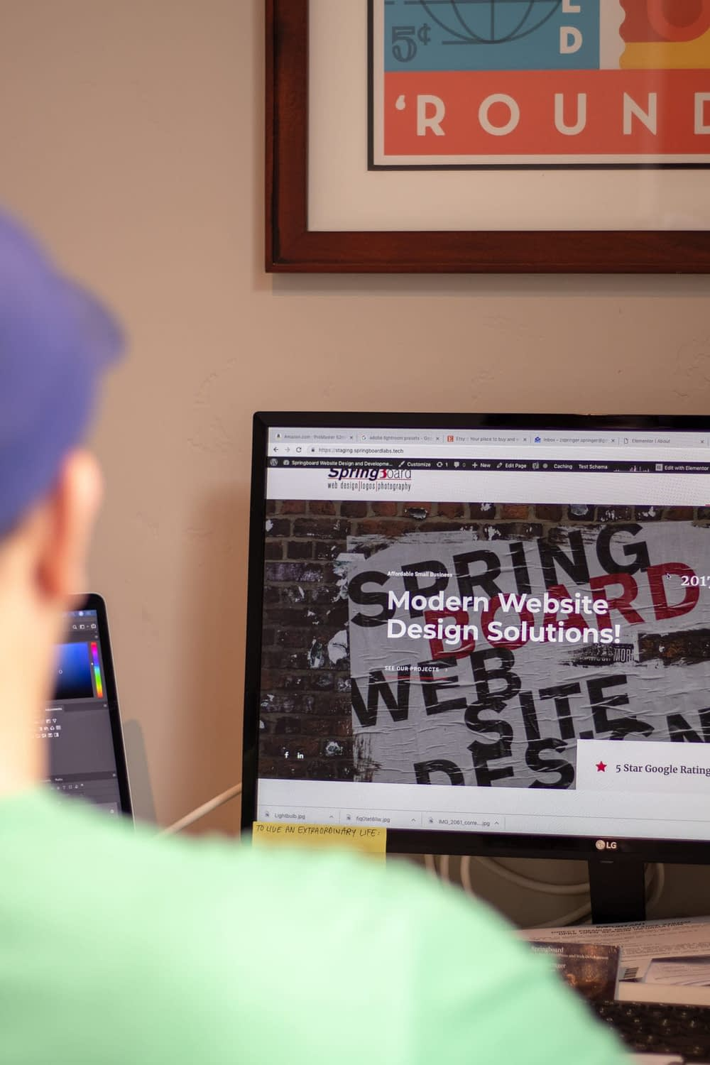 Zach Springer sitting at a computer with Springboard Website Design homepage showing