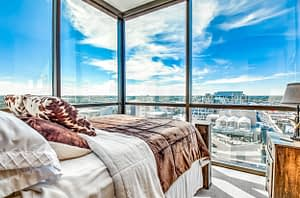 Real estate photography sample of a bedroom in a high rise building overlooking downtown Boise Idaho