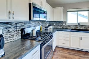 Real estate photograph of a kitchen featuring the oven and countertops