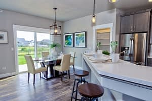 Real estate photography of a dining room with table