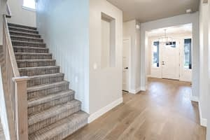 Real estate photography of a house entrance and stairs