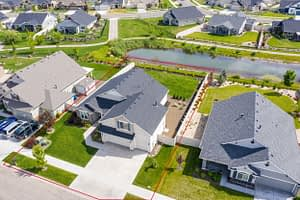 Drone aerial shot of a house with a red line indicating the property boundaries