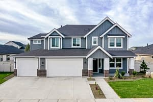 Real estate photography picture of the front of a two story blue house