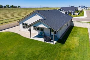 Real estate drone aerial shot of the backside of a house
