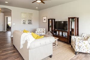 Real estate photography of a living room and tv on the wall