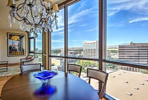 Real estate photography sample of a dining room overlooking the city of Boise