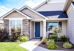 Real estate photography sample picture of a house with a blue door